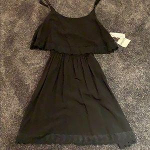 Garage black dress with lace trim
